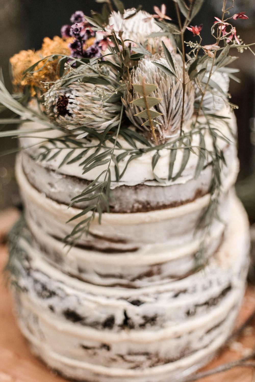 Rustic wedding cake with Australian native flowers